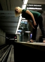 leaning over subway track